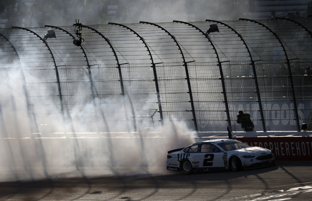 Brad Keselowski (2) performs a burnout after winning the Kobalt 400 at Las Vegas Motor Speedway in Las Vegas Sunday, March 6, 2016. Josh Holmberg/Las Vegas Review-Journal