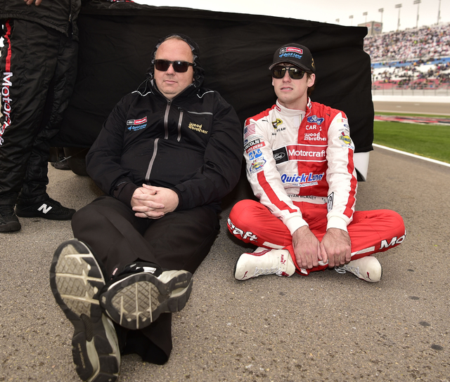 Ryan Blaney (21) waits out a rain delay with a crew member before the start of the Kobalt 400 at Las Vegas Motor Speedway in Las Vegas Sunday, March 6, 2016. Josh Holmberg/Las Vegas Review-Journal