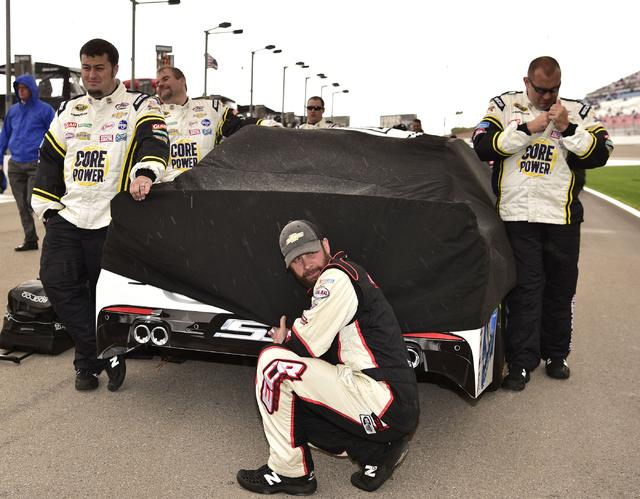 Crew members for A.J. Allmendinger (47) wait out a rain delay before the start of the Kobalt 400 at Las Vegas Motor Speedway in Las Vegas Sunday, March 6, 2016. Josh Holmberg/Las Vegas Review-Journal