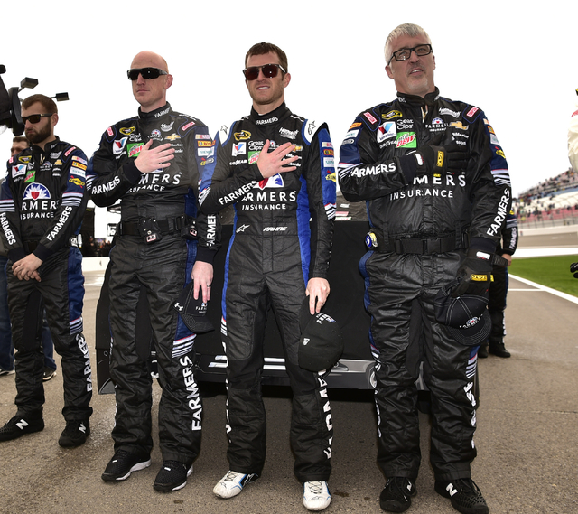 Kasey Kahne and crew members are seen during the national anthem before the start of the Kobalt 400 at Las Vegas Motor Speedway in Las Vegas Sunday, March 6, 2016. Josh Holmberg/Las Vegas Review-J ...