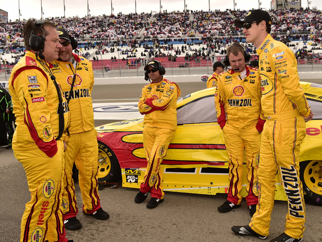 Joey Logano (22) waits out a rain delay with a crew member before the start of the Kobalt 400 at Las Vegas Motor Speedway in Las Vegas Sunday, March 6, 2016. Josh Holmberg/Las Vegas Review-Journal