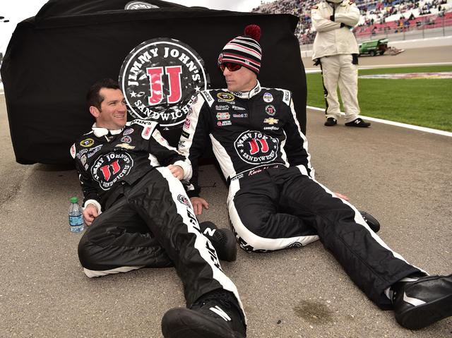 Kevin Harvick waits out a rain delay with a crew member before the start of the Kobalt 400 at Las Vegas Motor Speedway in Las Vegas Sunday, March 6, 2016. Josh Holmberg/Las Vegas Review-Journal