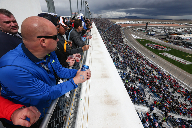 Fans watch as the NASCAR Sprint Cup Series Kobalt 400 race begins at the Las Vegas Motor Speedway in Las Vegas on Sunday, March 6, 2016. Chase Stevens/Las Vegas Review-Journal Follow @csstevensphoto