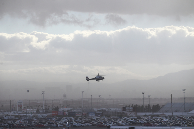 A helicopter attempts to land as dust and clouds cover the Las Vegas Valley during the NASCAR Sprint Cup Series Kobalt 400 race at the Las Vegas Motor Speedway on Sunday, March 6, 2016. Chase Stev ...