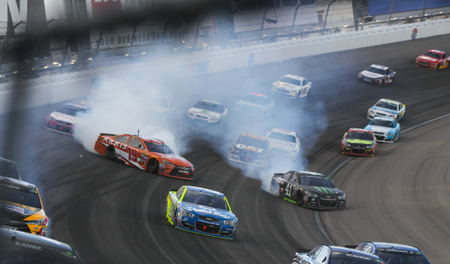 Carl Edwards (19) and Kurt Busch (41) spin out during the NASCAR Sprint Cup Series Kobalt 400 race at the Las Vegas Motor Speedway in Las Vegas on Sunday, March 6, 2016. Chase Stevens/Las Vegas Re ...