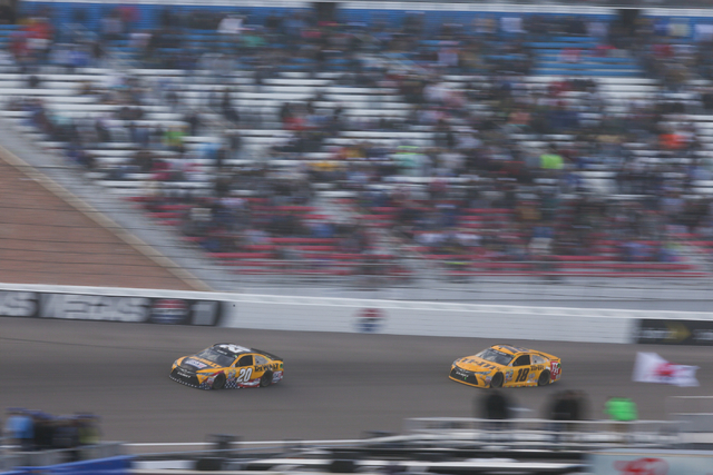 Matt Kenseth (20) and Kyle Busch (18) race during the NASCAR Sprint Cup Series Kobalt 400 race at the Las Vegas Motor Speedway in Las Vegas on Sunday, March 6, 2016. Chase Stevens/Las Vegas Review ...