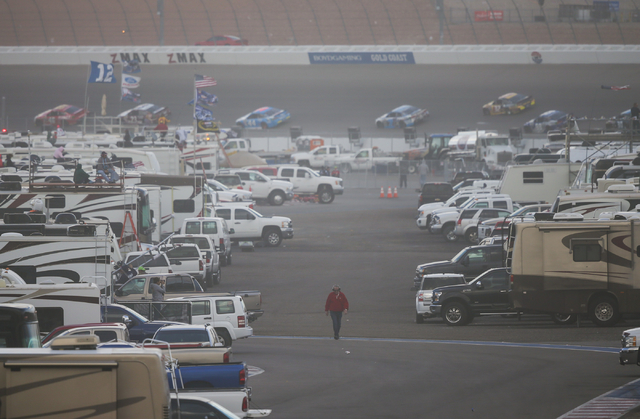 A man walks through an infield area during the NASCAR Sprint Cup Series Kobalt 400 race at the Las Vegas Motor Speedway in Las Vegas on Sunday, March 6, 2016. Chase Stevens/Las Vegas Review-Journa ...