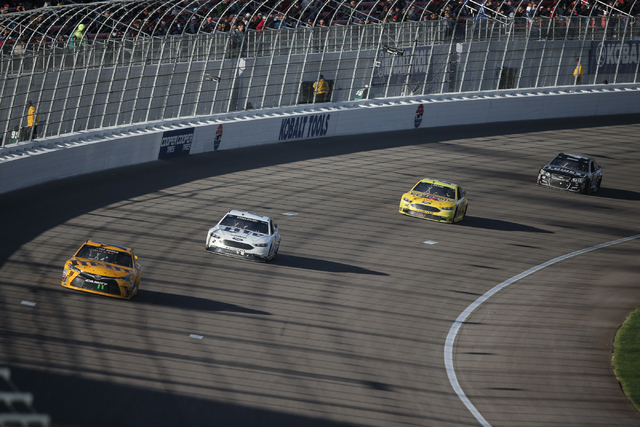 Brad Keselowski (2) approaches Kyle Busch (18) during the NASCAR Sprint Cup Series Kobalt 400 race at the Las Vegas Motor Speedway in Las Vegas on Sunday, March 6, 2016. Chase Stevens/Las Vegas Re ...