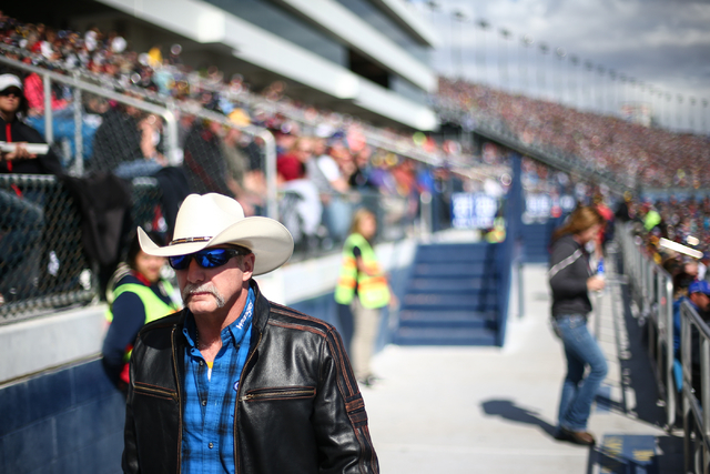 A fan walks by during the NASCAR Sprint Cup Series Kobalt 400 race at the Las Vegas Motor Speedway in Las Vegas on Sunday, March 6, 2016. Chase Stevens/Las Vegas Review-Journal Follow @csstevensphoto