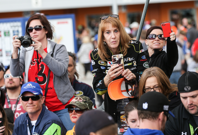 Fans look to take photos of drivers before the NASCAR Sprint Cup Series Kobalt 400 race at the Las Vegas Motor Speedway in Las Vegas on Sunday, March 6, 2016. Chase Stevens/Las Vegas Review-Journa ...