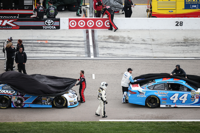 Crew members uncover drivers' cars before the NASCAR Sprint Cup Series Kobalt 400 race at the Las Vegas Motor Speedway in Las Vegas on Sunday, March 6, 2016. Chase Stevens/Las Vegas Review-Journal ...