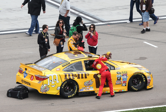 Kyle Busch (18) spends a moment with his family before the NASCAR Sprint Cup Series Kobalt 400 race at the Las Vegas Motor Speedway in Las Vegas on Sunday, March 6, 2016. Chase Stevens/Las Vegas R ...