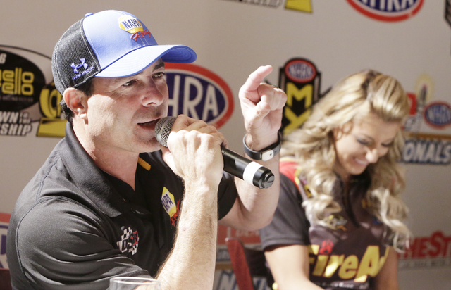 NHRA Top Fuel driver Leah Pritchett, right, laughs as Funny Car driver Ron Capps, speaks during the NHRA Mello Yello Drag Racing Series official event press conference at The Palm Restaurant at Ca ...