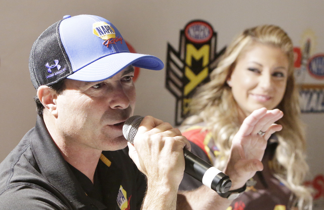 NHRA Funny Car driver Ron Capps, left, speaks as Top Fuel driver Leah Pritchett, right, looks on during the NHRA Mello Yello Drag Racing Series official event press conference at The Palm Restaura ...