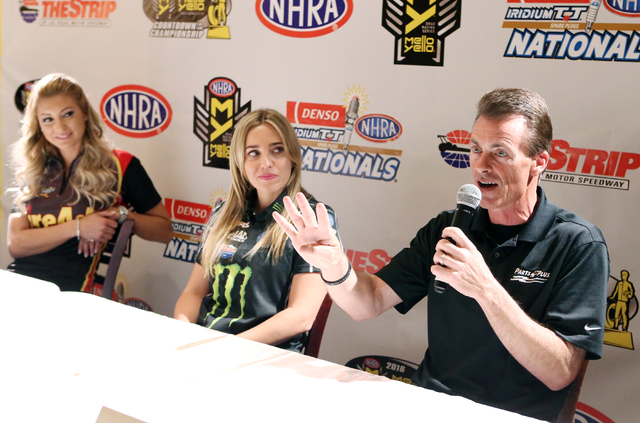 NHRA Veteran Top Fuel driver Clay Millican, right, speaks as Top Fuel driver Leah Pritchett, left, and Top Fuel driver Brittany Force, center, look on during the NHRA Mello Yello Drag Racing Serie ...