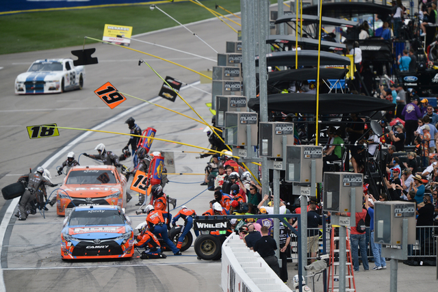 BRETT LE BLANC/LAS VEGAS REVIEW-JOURNAL / FOLLOW HIM @BLEBLANCPHOTO Kyle Busch (18) and Daniel Suarez (19) make pit stops during the Xfinity Series Boyd Gaming 300 at Las Vegas Motor Speedway on S ...