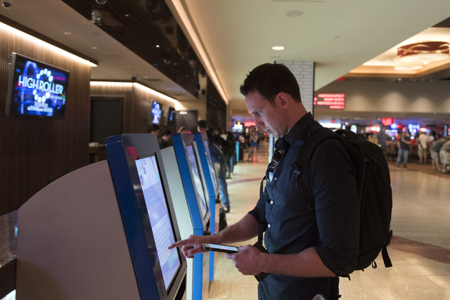 Austin Dillman of San Francisco uses one of the seven new self check-in kiosks located in the lobby at The Linq Hotel in Las Vegas Wednesday, March 16, 2016. Jason Ogulnik/Las Vegas Review-Journal