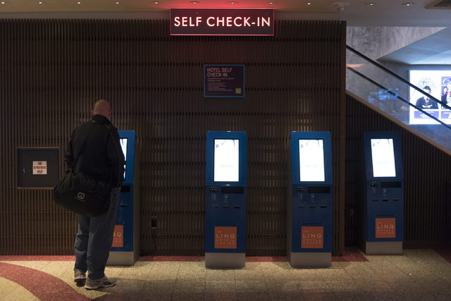 A man uses one of the seven new self check-in kiosks located in the lobby at The Linq Hotel in Las Vegas Wednesday, March 16, 2016. Jason Ogulnik/Las Vegas Review-Journal