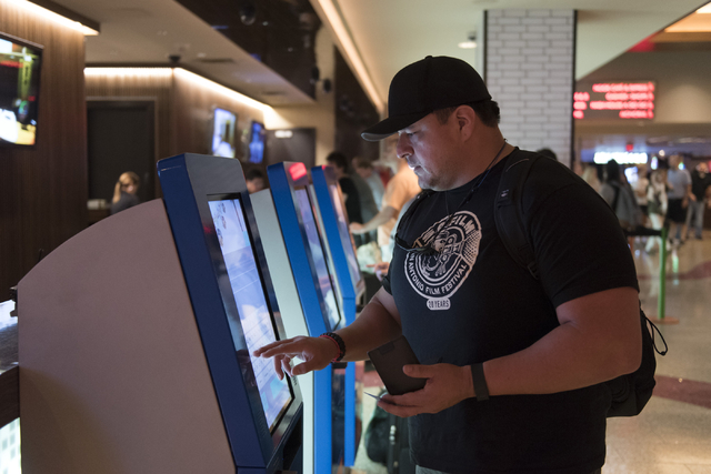 Ray L. Perez of Austin, Texas, uses one of the seven new self check-in kiosks located in the lobby at The Linq Hotel in Las Vegas Wednesday, March 16, 2016. Jason Ogulnik/Las Vegas Review-Journal