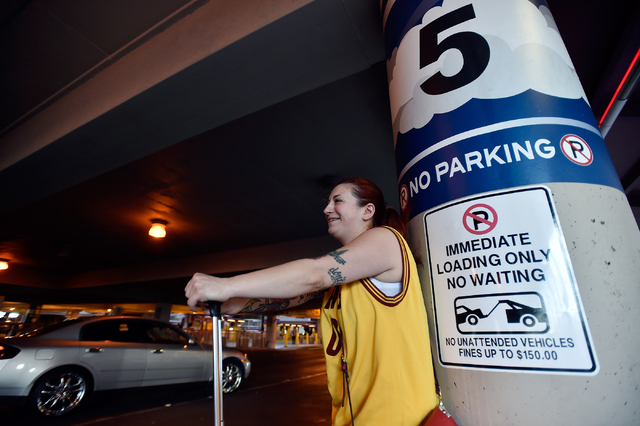 Genevieve Kocak of Las Vegas waits for her ride in the passenger pick-up area at McCarran International Airport Monday, March 14, 2016, in Las Vegas. A cellphone lot was established earlier this m ...