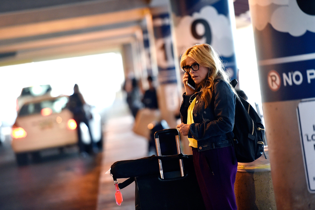 Nanette Guild of Henderson speaks on her cellphone as she waits for her ride in the passenger pick-up area at McCarran International Airport, Monday, March 14, 2016, in Las Vegas. A cellphone lot  ...
