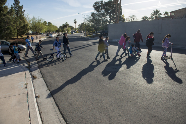 Students, administrators and parents walk Wednesday, March 6, 2016, to honor  Maxine Lopez, 12, who recently died after being taken to the hospital with pain in her neck and thighs. The walk, whic ...