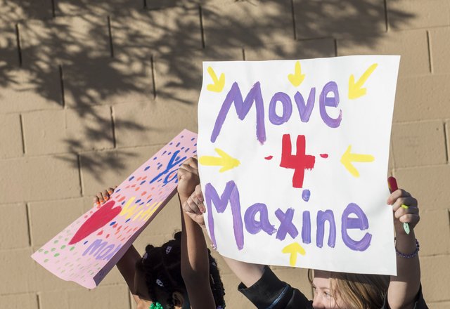 Students walk Wednesday, March 6, 2016, to honor  Maxine Lopez, 12, who recently died after being taken to the hospital with pain in her neck and thighs. The walk, which went from Kenny Guinn Midd ...