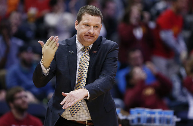 Arkansas Little Rock coach Chris Beard signals for a timeout in first half action of Iowa State vs Arkansas Little Rock during the second round of the 2016 NCAA Tournament at Pepsi Center in Denve ...