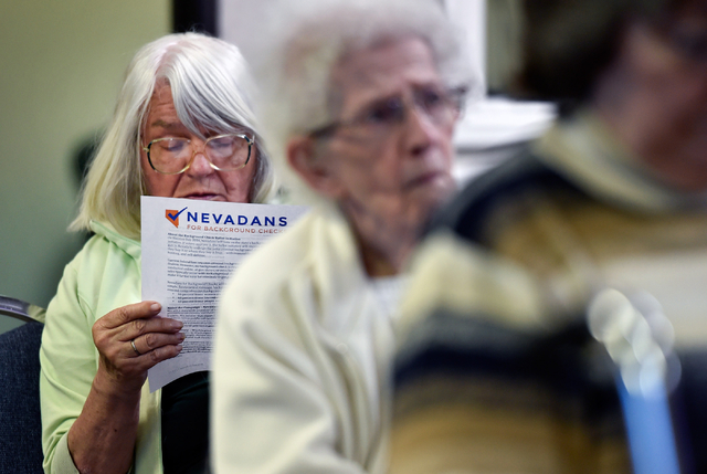 Sylvia Hackethorn reads during a meeting on a proposed gun background check initiative at the Journey United Methodist Church Monday, March 14, 2016, in Las Vegas. David Becker/Las Vegas Review-Jo ...