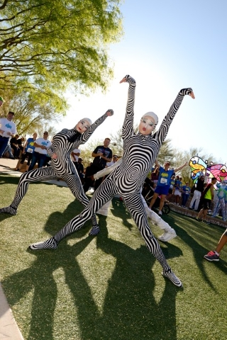 Acrobatic dancers perform at the 2015 Run Away with Cirque du Soleil community 5K run and 1-mile fun walk. This year's run is set for March 12 at the Springs Preserve, 333 S. Valley View Blvd. Spe ...