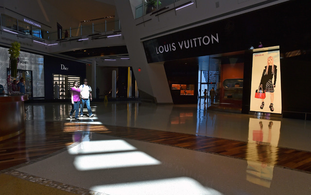 A couple walks through a ray of sunlight inside the Shops at Crystals at CityCenter Friday, March 18, 2016, in Las Vegas. MGM Resorts International entered into an agreement to sell the 324,000 sq ...