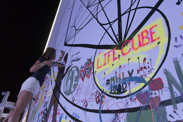 Kimberly Deiorio paints during the illumination ceremony for the Life Cube in the Llama Lot at Fremont Street and 9th Street in Las Vegas Saturday, March 19, 2016. The ceremony kicks off two weeks ...