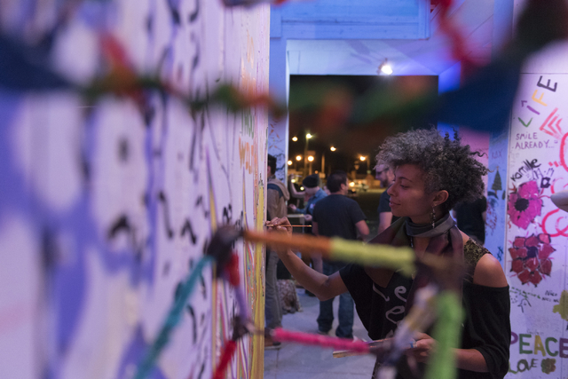 Brianna Coleman paints during the illumination ceremony for the Life Cube in the Llama Lot at Fremont Street and 9th Street in Las Vegas Saturday, March 19, 2016. The ceremony kicks off two weeks  ...