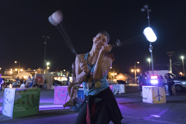 Sheri Kaminski dances with globe pois during the illumination ceremony for the Life Cube in the Llama Lot at Fremont Street and 9th Street in Las Vegas Saturday, March 19, 2016. The ceremony kicks ...