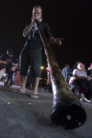 Farren Tayler plays a didgeridoo during the illumination ceremony for the Life Cube in the Llama Lot at Fremont Street and 9th Street in Las Vegas Saturday, March 19, 2016. The ceremony kicks off  ...