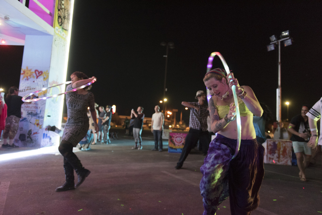 Dancers perform with hula hoops during the illumination ceremony for the Life Cube in the Llama Lot at Fremont Street and 9th Street in Las Vegas Saturday, March 19, 2016. The ceremony kicks off t ...