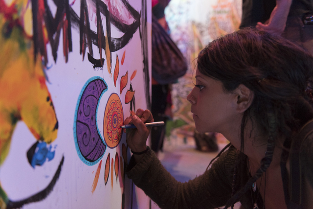 Ali Pullen paints during the illumination ceremony for the Life Cube in the Llama Lot at Fremont Street and 9th Street in Las Vegas Saturday, March 19, 2016. The ceremony kicks off two weeks of cu ...