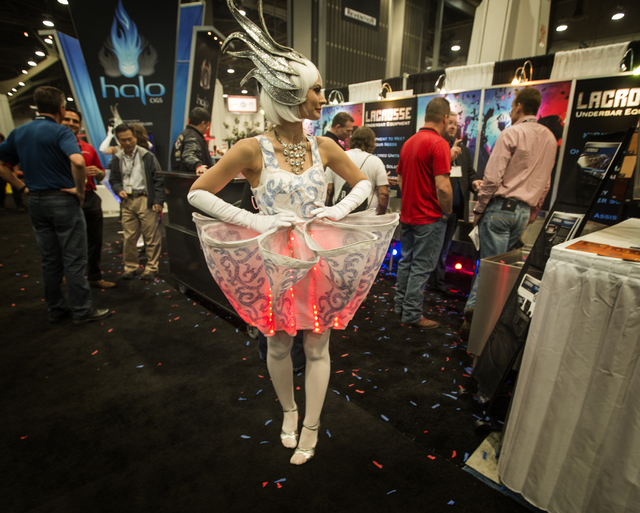 Model Ashley (declined to give last name) wears a LED cupcake dress at the Nightclub & Bar Convention & Trade Show in the Las Vegas Convention Center on Tuesday,  March 8, 2016. Jeff Schei ...