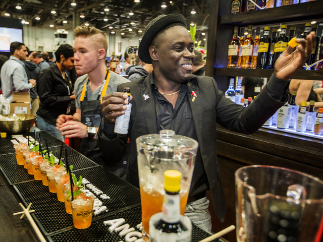Mixologist Raymond Edwards serves Queen Park Swizzle in the Angostura booth at the Nightclub & Bar Convention & Trade Show in the Las Vegas Convention Center on Tuesday,  March 8, 2016. Je ...