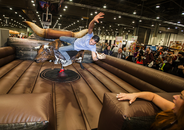 BMX Pro rider Ricardo Laguna get bucked off a mechanical bull at the Nightclub & Bar Convention & Trade Show in the Las Vegas Convention Center on Tuesday,  March 8, 2016. Jeff Scheid/Las  ...