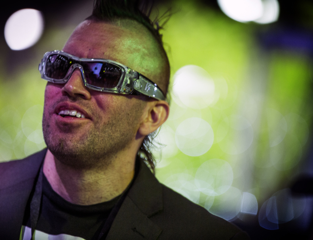 Michael Boise wears a pair of Rhythm Vision glasses listening to music in the ADJ Group booth at the Nightclub & Bar Convention & Trade Show in the Las Vegas Convention Center on Tuesday,  ...