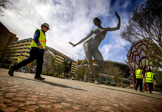 "The ""Bliss Dance"" sculpture created by artist Marco Cochrane is seen during an unveiling at The Park, MGM Resorts International's outdoor dining and entertainment district, on Friday, March 4, 201 ..."
