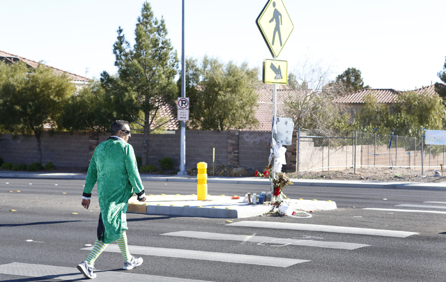 Clark County School District detective Thomas Rainey, dressed as a leprechaun, crosses Jones Boulevard as he participates in a pedestrian safety event on Friday, March 13, 2015. An officer will be ...