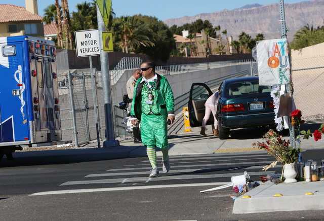Clark County School District detective Thomas Rainey, dressed as a leprechaun, crosses Jones Bouelvard as he participates in a pedestrian safety event on Friday, March 13, 2015.An officer will be  ...