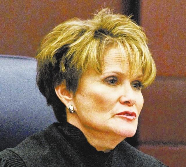 Nevada Supreme Court Chief Justice Nancy M. Saitta listens during arguments in Wayne Davenport v. GMAC at the Regional Justice Center, Monday, Dec. 5, 2011. (File, Jerry Henkel/Las Vegas Review-Jo ...