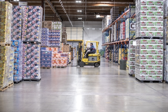 An employee moves cases of beer at Bonanza Beverage Company in Las Vegas on Wednesday, Feb. 17, 2016. Joshua Dahl/Las Vegas Review-Journal