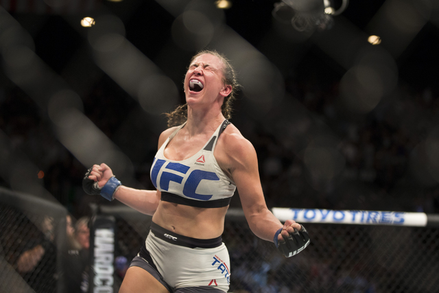 Miesha Tate reacts to her victory against Holly Holm by way of submission in their women's bantamweight title bout during UFC 196 at MGM Grand Garden ArenaSaturday, March 5, 2016, in Las Ve ...