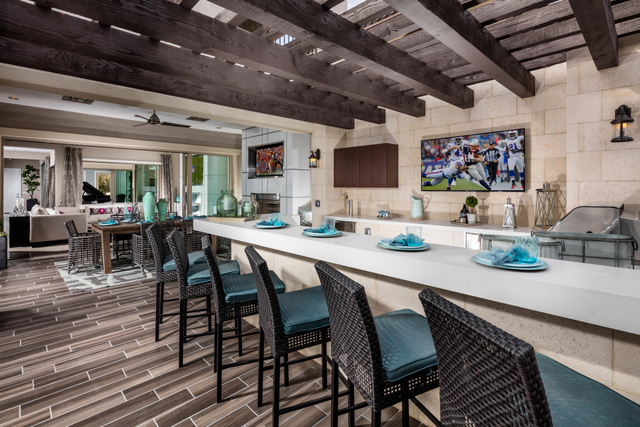 COURTESY TOLL BROTHERS An outdoor patio bar is featured in Toll Brothers' Venosa model at Altura.