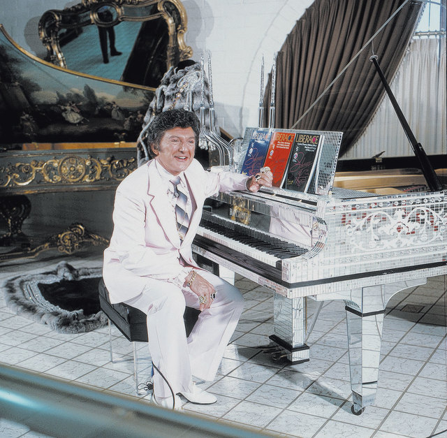 Liberace poses at a piano in his namesake museum at when it opened at 1775 E. Tropicana Ave. in 1979. (Courtesy/Las Vegas News Bureau)