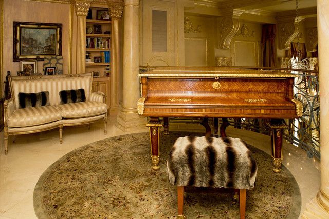 A second-story cantilever housing an Old World-looking grand piano is directly above the kitchen and overlooks the living room. (Tonya Harvey/Real Estate Millions )